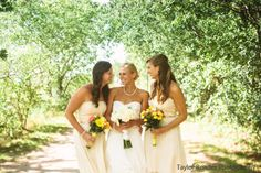 A beautiful bride with her bridesmaids in the Donna dress in Candlelight
