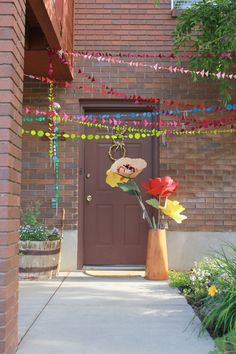 Surprise garlands at the door for a birthday.