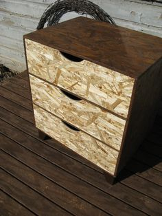 modular OSB brown dresser with black scoop pulls. $149.00, via Etsy.