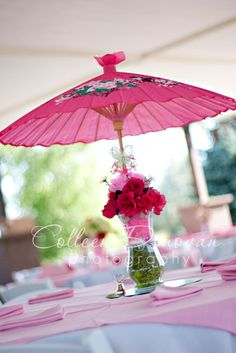 I love these parasol centerpieces! The bright color makes a bold statement (but it would look classy in white or neutrals too), and it cuts down on the amount of flowers you need for a sizable centerpiece.    Creative Wedding Ideas.