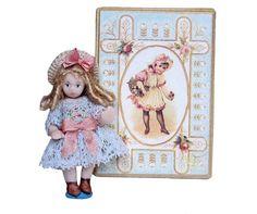 "Nelly Nooren - porcelain doll, 1.75"" High"
