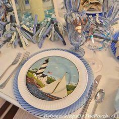 A nautical tablescape for Tablescape Thursday. #warrenkimblefolkart #sailboatflatware #TablescapeThursday