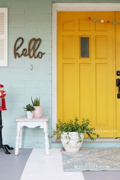 white front door yellow house. colorful front porch ideas and tips lots of pretty decor by layering textures white door yellow house