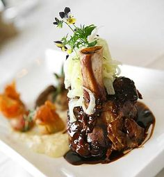 Braised Pork Shank with Roasted Porcini with Fennal and Apple Slaw, Truffle Polenta and Roasted Tomatoes.