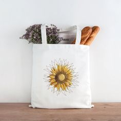 A great tote bag can be everything! This roomy and durable tote bag is great for carrying everything: books, crafting supplies, groceries, and anything else you need to take with you. Each bag is printed to order with the design shown in the first image.  It makes a great gift for a friend, teacher, loved one, or yourself!  ------------------------------------------------------------------- DETAILS:   • 12 oz., 100% cotton canvas  • Reinforced bottom  • 22 handles (approximately 9 drop)  •…