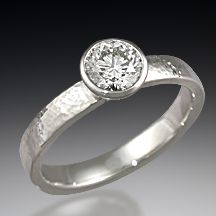 Modern Hammered Engagement Ring - Are you looking for a contemporary engagement ring design with character?  Then hand-hammering may be the right finishing touch!  This solitaire engagement ring is textured with round indentations  www.krikawa.com