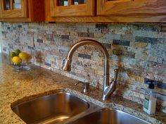 Sunset Blend with New Venetian Gold Countertops. The texture is in the cleated stone. Again...notice the outlet. Nice splash idea but the stone could be a little simpler.