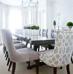 A little too formal for my taste but I love the mixture of solid and pattern upholstery