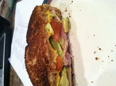 Grilled tomato, avocado, ham and cheese sandwich