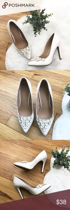 """LC Lauren Conrad Petal White Heels LC Lauren Conrad Petal White Heels Size 6.5 New, will come WITHOUT box. New condition. Minor imperfection, from trying on, on inside of left shoe- shown in 4th photo.   Man made / Textile.  Heel height measures 4"""".  🎀All items from a clean & smoke free home.   👌🏻Quick shipping.   💁🏻Offers welcome through """"Make an Offer"""" feature.   ❓Feel free to ask any questions. LC Lauren Conrad Shoes Heels"""