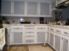 Kitchen:White Kitchen Cabinet Grey Door Brown Tile Floor Ceramic Tile Wall Banana Brown Bowl Stainless Bowl White Towel Brown Carpet Seasoning Set Shakers Sink Plant Yellow Vase The Cute Two Tone Kitchen Cabinet
