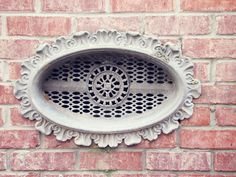Ornate grate in the Cotton District > located between Downtown & Campus