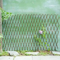 """Expandable to fit in a variety of garden spaces, this natural willow fence is a decorative and practical support for climbing plants.- Willow branches, galvanized metal nails- Imported17-45""""H, 1.5-18'L"""