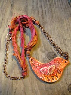 Mixed Media Rustic Boho Polymer Clay Pink and Orange Love Bird Necklace on Copper Chain and Sari Silk Ribbon