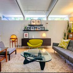 Mid Century Modern Living Room. Grey sofa is lovely and the boomerang table is cool. Too much good stuff to mention