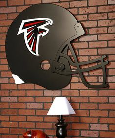 This spirited helmet-shaped art boasts the team's colors and a 3-D logo, making it a great gift for fans both big and small. Its durable construction, sturdy ring brackets and oversize design ensure once-bare walls will show sporty support for many seasons to come.