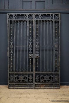 A pair of wrought iron internal doors with overdoor. Secondary opening frames to the rear of all that would have been glazed with clear glass or mirror. French, early 20th century