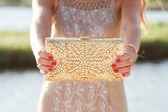 Gorgeous gold clutch featured in Beach photoshoot by @eleephoto on the mississippi gulf coast featuring Ivy's summer outfits! Ivy Boutique is located in D'Iberville, MS! Call us 228-354-8499 or visit us on Instagram @ivyboutiquems or Facebook.com/growyourstyle!