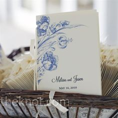 Continuing with the natural motif, the simple ceremony programs featured a navy floral illustration.