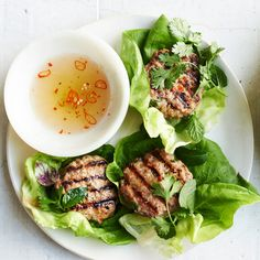 In Vietnam, little pork patties like this are often grilled over charcoal right on the street and diners sit and eat on (now iconic) little plastic stools. You can serve these patties simply wrapped in the lettuce leaves here, as a snack, or over vermicelli noodles, as a larger meal. What's non-negotiable? Serve with plenty of herbs and the funky, salty, sour, sweet dipping sauce.