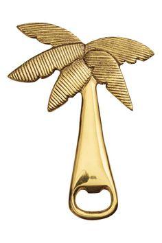 Metalen flesopener: Een flesopener van goudkleurig metaal in de vorm van een palmboom. Lengte ca. 14 cm.