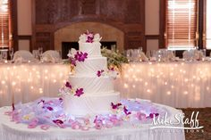 #wedding cake #wedding cake topper #tiered cake #Michigan wedding #Mike Staff Productions #wedding details #wedding photography http://www.mikestaff.com/services/photography #white #purple #flowers #draped