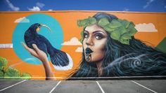 Street artist Erika Pearce's large mural on the wall of the Gooses Screen Design in Allen St.