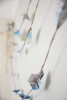 Paper airplane garland hand folded from old road maps. ***DETAILS*** Each strand contains 10 origami planes on twine rope and measures just over 10 long. Hang them over a doorway, around a tree or even stream a few across a room. These garlands are perfect for a travel theme party,