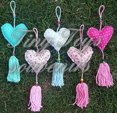 40 corazones de tela con borla de lana + corazón central