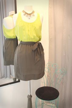 neon top with grey skirt