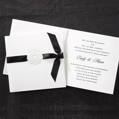 The Gift Wedding Invitation 40% Off http://mediaplus.carlsoncraft.com/3124-BSF1311-The-Gift--Invitation.pro BSF1311 A detailed round pearl design is centered on the front of this invitation with a black satin ribbon streaming through it.