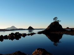 Whakatane Heads with Whale Island in the background.