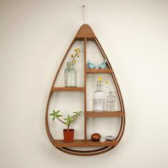 Make a statement on your wall with our Mid-Century Teardrop Shelf. It doubles as convenient, creative storage, with shelving space for frames, decorative plants, and other knickknacks. Handmade in Maine with extra care, youll enjoy this stylish piece for years to come!  Dimensions - This shelf measures at 28 x 16.5 x 3.5 and is made of red cedar and pine with a mahogany stain. Gifts - Our bentwood shelves make excellent gifts for house warmings, newly weds, the home decor fanatic, and anyone…