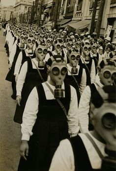 schoolgirls in gas masks. WWII.