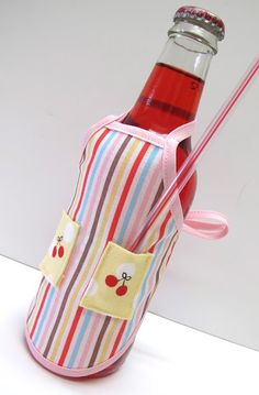 this will be made!! so stinking cute! an apron for a soda bottle with a pocket for a straw! what a cute gift idea!