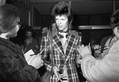Epitome of cool: Michael Jang snapped pop icon David Bowie signing autographs for fans at The Beverly Hilton Hotel in 1972, the same year he released his album 'The Rise and Fall of Ziggy Stardust and the Spiders from Mars'
