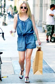 Dakota Fanning wears a cool denim drawstring romper with clear-frame sunglasses // #StreetStyle #Summer