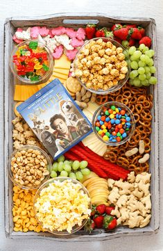 Creating a Movie Night Snack Board is a fantastic family night in idea to enjoy all your favorite snacks like fresh fruits, cheeses, crackers, popcorn and candy while watching the newly released Dolittle DVD! Charcuterie Recipes, Charcuterie And Cheese Board, Charcuterie Platter, Cheese Boards, Appetizer Recipes, Snack Recipes, Sandwich Recipes, Party Recipes, Dinner Recipes