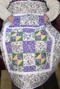 Lovie Lap Quilt ~ two pockets, flannel lined, one through pocket to keep your hands warm and the other pocket for  items you would like to have handy. The flannel back gives it that extra warm cozy feel.