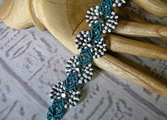 Micro macrame bracelet in teal white and silver.. $31.99, via Etsy.