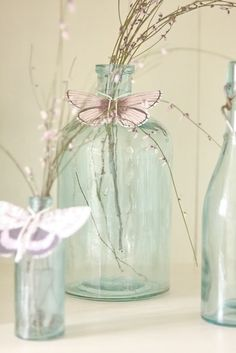 I have such a soft spot for simple glass bottles & jars dressed up Ana Rosa