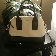 """Authentic Kate Spade Southport Avenue Jenny Small Beautiful buttermilk / black pebble embossed cowhide, zip closure with gold plated hardware & a removable adjustable strap. Measurements: 9""""h x 11.2w x 4.9d drop length 4.7"""" strap length 47.6"""" This bag is in excellent condition, worn gently for one week. No Trades! kate spade Bags"""