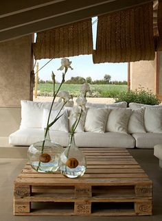 Pallet outdoor table, woven shades, and white cushions; It looks like the white cushions are on a cement made sofa. Then you'd have seating all year round- minus the pads in winter. Outdoor Rooms, Outdoor Living, Outdoor Decor, Outdoor Furniture, Farmhouse Furniture, Outdoor Seating, Pallet Furniture Designs, Upcycled Furniture, Woven Shades