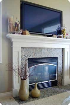 Love: white woodwork / mantle / tile---put stone in place of the tile on fireplace?