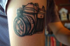 camera tattoo. Love the sketched quality of this tat.
