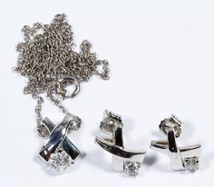 Lot 211: 10k White Gold and Diamond Jewelry Suite; Pendant and pierced earrings, each having a round cut diamond weighing approximately 0.10CT for a total of 0.30CTtw and a necklace; all marked 10k