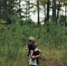 """this little girl could be me with my kitty . . wavy blonde hair + carrying naughty kitty home. . the cat is like mine (rip) because he's just like, """"eh... fine."""""""