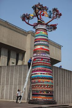 Mike De Butts adds the finishing touches to a giant Baobab Tree sculpture entitled 'Under the Baobab', outside the Southbank Centre on May 2...