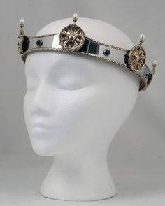 SCA Baronial Coronet in Stainless Steel, Bronze, Garnets, and Pearls  For my purposes, replace the roses with owls  =)