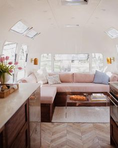 Tour a Tiny Blush Pink Airstream Designed by The Modern Caravan Are you a nomad at heart? Then you'll want to peek inside this ultra-chic Airstream designed by Kate and Ellen of The Modern Caravan. The super stylish mobile abode boasts herringbone floors, Airstream Living, Airstream Remodel, Airstream Renovation, Airstream Interior, Vintage Airstream, Trailer Remodel, Airstream Trailers, Trailer Interior, Vintage Caravans